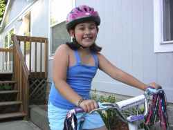 Girl wearing a helmet while riding her bike