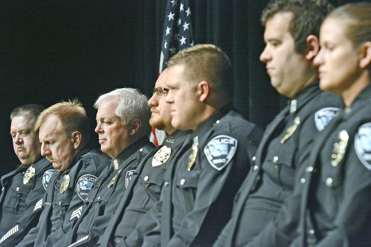 Mount Vernon and Burlington officers sit together during a ceremony honoring their response to a Mt